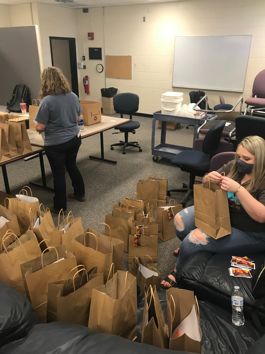 Gracey Law, right, and other MTSU School of Agriculture agritourism class members prepare the Harvest Handbags, which were taken to Homer Pittard Campus School. (Submitted photo MTSU agritourism class)