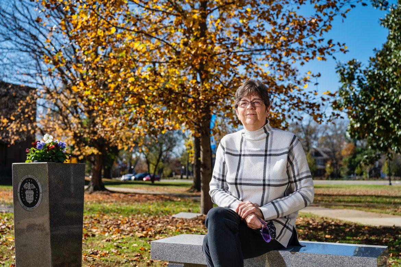 Rebecca Calahan, Mathematical Sciences faculty at the Veterans Memorial. (Photo: Andy Heidt)