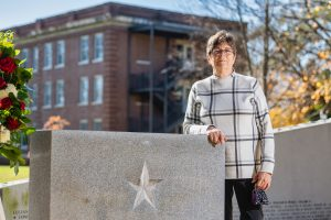 Rebecca Calahan, Mathematical Sciences faculty at the Veterans Memorial. (Photo: Andy Heidt)