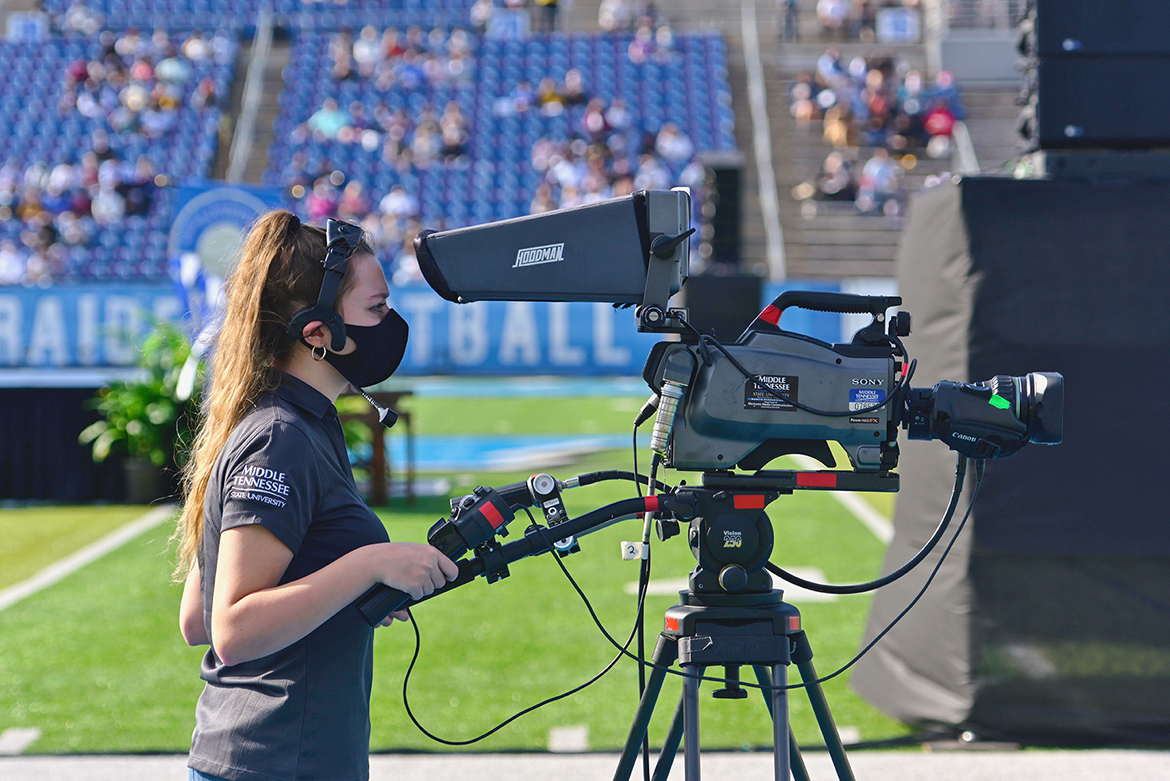 A student videographer captures live coverage of one of the three Fall 2020 commencement ceremonies held Nov. 21 at Floyd Stadium. Students from the College of Media and Entertainment's Department of Media Arts, as well as students working for the university's Production Services team, produced True Blue TV's coverage. The three ceremonies will re-air for 24 hours on Saturday, Nov. 28, on True Blue TV. (MTSU photo)