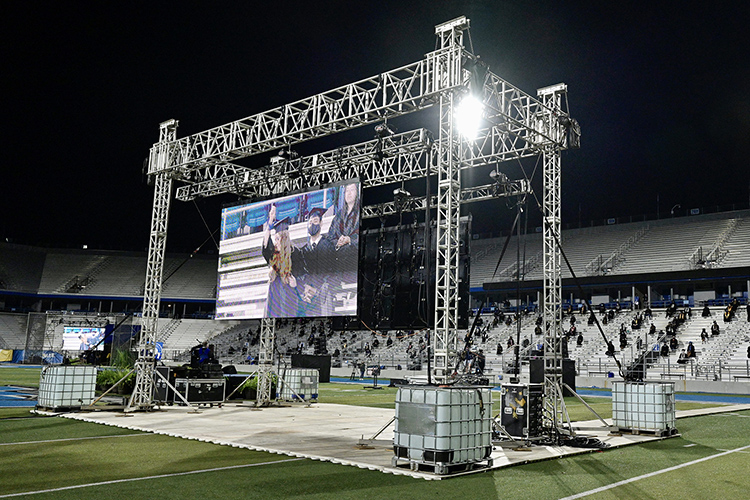 A large video screen displays one of the almost 400 graduates from May and August who chose to attend the Saturday, Nov. 21, outdoor Fall 2020 commencement ceremony at Floyd Stadium after MTSU moved its Spring and Summer 2020 commencements to a virtual format because of the COVID-19 pandemic. The three livestreamed ceremonies held Nov. 21 will re-air for 24 hours on Saturday, Nov. 28, on True Blue TV. (MTSU photo by Andy Heidt)