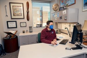 Tyler Babb, Professional Pilot Concentration Coordinator, Aerospace faculty in and around the Business and Aerospace Building. (Photo: Andy Heidt)