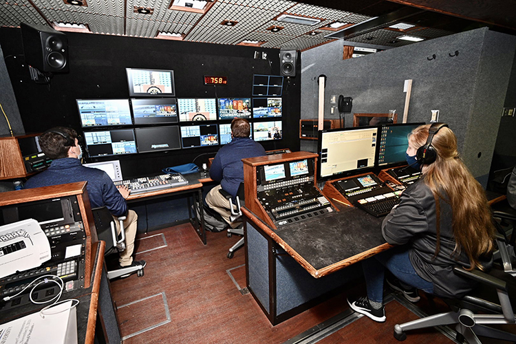 Members of MTSU's student-operated Media Arts Productions crew produce the university's fall 2020 commencement ceremonies in Floyd Stadium Saturday, Nov. 21, from the control room of the College of Media and Entertainment's $1.7 million Mobile Production Truck. MTSU, which held virtual graduations for its May and August graduates because of the pandemic, conducted its only in-person ceremony for the Class of 2020 with strict health protocols to keep the three open-air events safer. (MTSU photo by J. Intintoli)