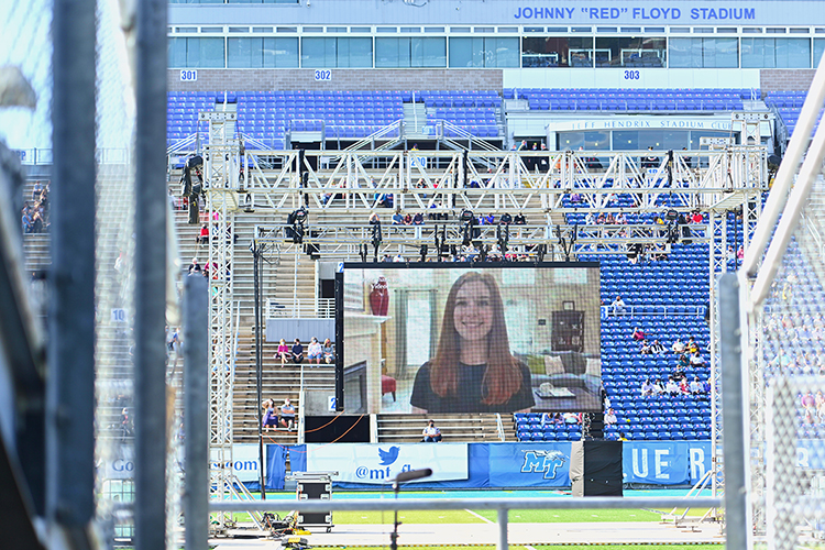 A graduating student's thank-you video plays on the Jumbotron in MTSU's Floyd Stadium Saturday, Nov. 21, before the university's fall 2020 commencement ceremonies. MTSU, which held virtual graduations for its May and August graduates because of the pandemic, required strict health protocols for the graduates and limited their guests to help keep the three open-air events safer. (MTSU photo by Cat Curtis Murphy)