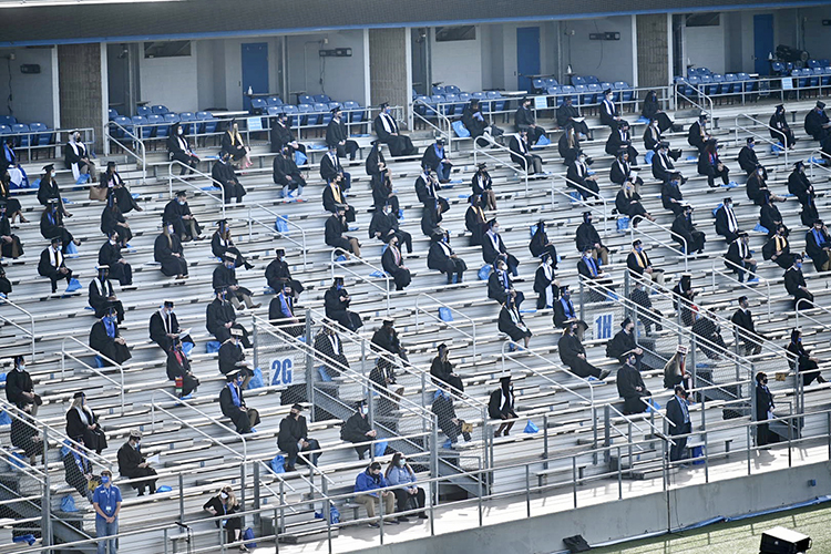 Graduating MTSU students sit, safely distanced and masked, on the east side of Floyd Stadium Saturday, Nov. 21, during the university's fall 2020 commencement ceremonies. MTSU, which held virtual graduations for its May and August graduates because of the pandemic, required strict health protocols for the graduates and limited their guests to help keep the three open-air events safer. (MTSU photo by J. Intintoli)