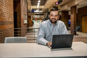 Matthew Taylor, Journalism and Strategic Media faculty, in and around the Bragg Media and Entertainment Building. (Photo: Andy Heidt)