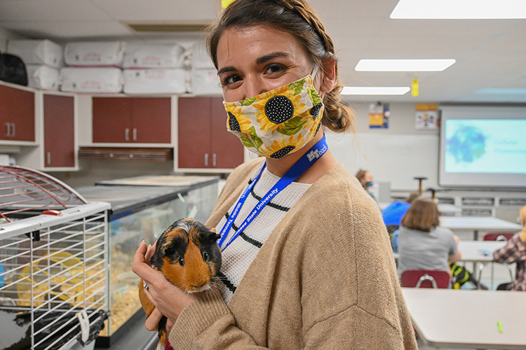 MTSU teacher candidate student Sarah Martin shows off a guinea pig at Eagleville High School in Eagleville, Tenn., on Oct. 14, 2020. (MTSU photo by Stephanie Barrette)