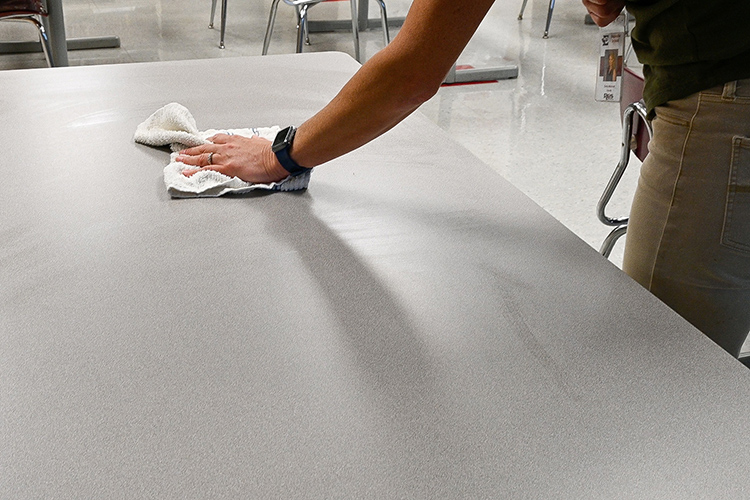 Agriculture teacher Emily Marshall sanitizes the tables in her classroom between classes at Eagleville High School in Eagleville, Tenn., on Oct. 14, 2020. (MTSU photo by Stephanie Barrette)