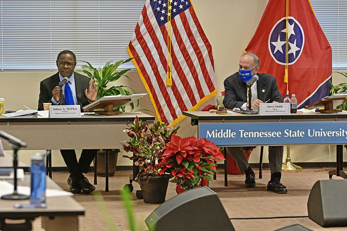 MTSU President Sidney A. McPhee, left, gives his report to the Board of Trustees during its meeting held Tuesday, Dec. 8, 2020, inside the Miller Education Center. At right is Board Chairman Stephen Smith. (MTSU photo by Andy Heidt)