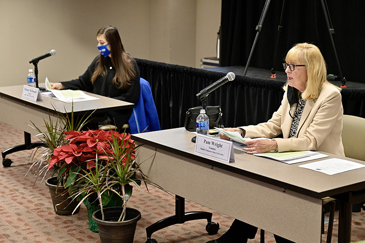 MTSU Trustee Pam Wright, right, gives the report of the Academic Affairs, Student Life and Athletics Committee, which she chairs, during the Board of Trustees meeting held Tuesday, Dec. 8, 2020, inside the Miller Education Center. At left is Student Trustee Delanie McDonald. (MTSU photo by Andy Heidt)