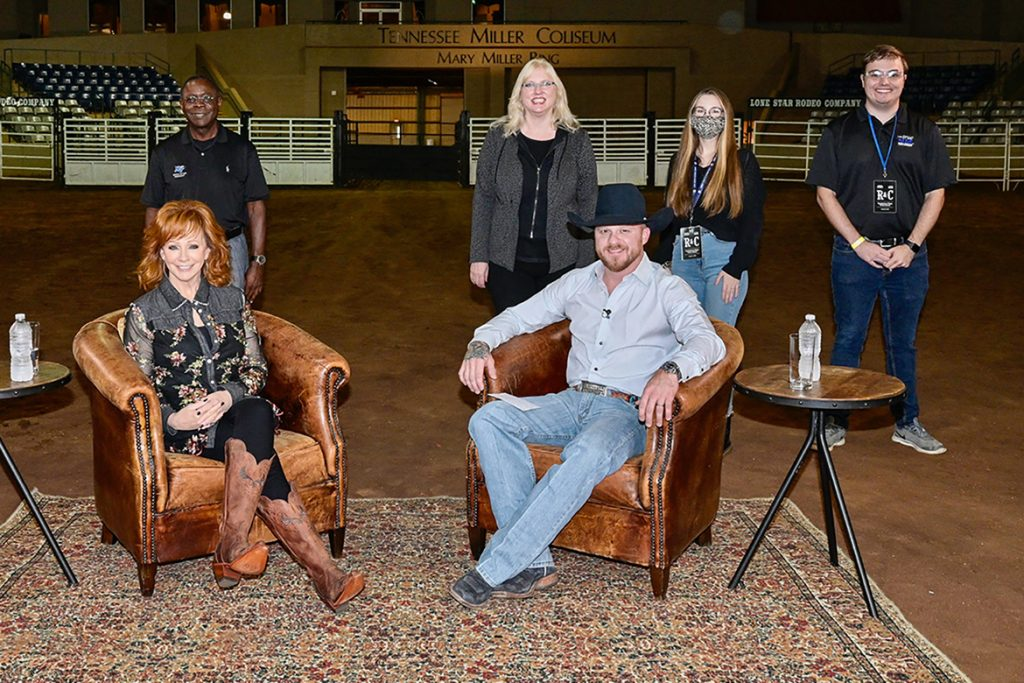"""Middle Tennessee State University staff, who coordinated the music video shoot for country music artists Reba McEntire and Cody Johnson's single """"Dear Rodeo,"""" pose for a photo on set at MTSU's Tennessee Miller Coliseum in Murfreesboro, Tenn., on Oct. 1, 2020. Standing in the top row, from left, are MTSU President Sidney A. McPhee, Media and Entertainment Dean Beverly Keel, student worker Sarah Oppmann and video field producer Kobe Hermann. Sitting in the bottom row, from left, are Reba McEntire and Cody Johnson. (MTSU photo by Andy Heidt)"""