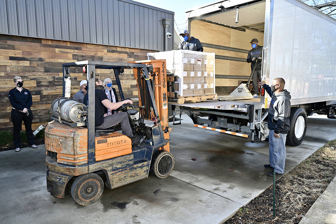 A pallet of 6,000 personal-sized bottles of Lightning Hand Sanitizer is being loaded Friday, Jan. 15, onto a Middle Tennessee State University truck by Big Machine Vodka for delivery from the distillery's Nashville, Tenn., location to MTSU. The university contracted with Big Machine to acquire sanitizer for students living in on-campus residence halls. (MTSU photo by Andy Heidt)