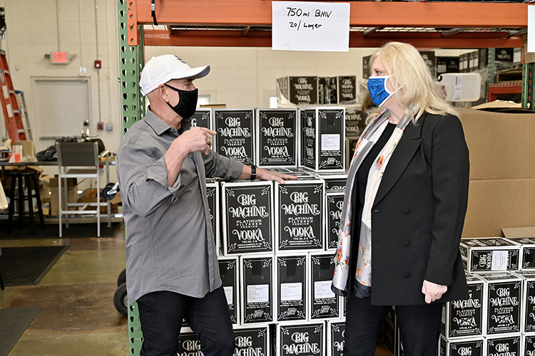 Mark Borchetta, executive vice president of Big Machine Vodka, gives Beverly Keel, dean of MTSU's College of Media and Entertainment, a tour of the company's work area behind its tavern on 3rd Avenue South in Nashville, Tenn. (MTSU photo by Andy Heidt)
