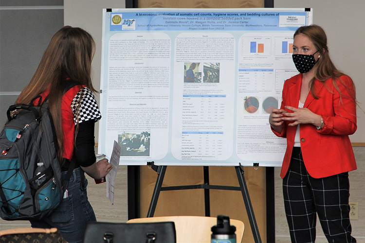Gabrielle Mould, an undergraduate Middle Tennessee State University agriculture student, shares her research with others at the MTSU Undergraduate Research Open House event held Nov. 10, 2020, in the Science Building mezzanine on campus. (MTSU photo by Casey Penston)