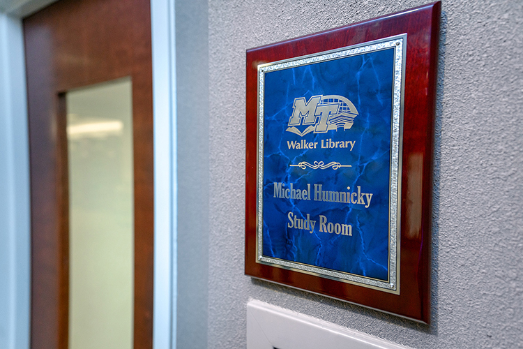 This plaque identifies the study room behind the door as the Michael Humnicky Study Room at the James E. Walker Library to honor a devoted donor of books and funding. (MTSU Photo by j. Intintoli)