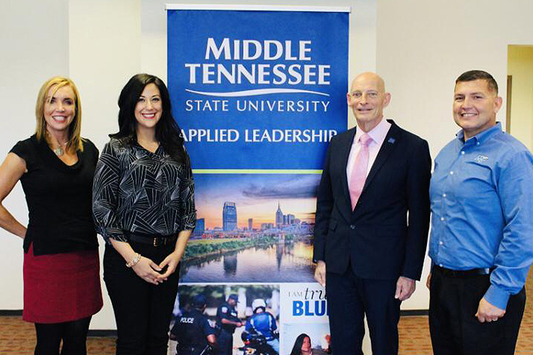 Pictured in this undated photo, from left, are Hilary Miller, director of the Charlie and Hazel Daniels Veterans and Military Family Center; MTSU student and working professional Cristin Wittwer; Keith M. Huber, senior adviser for veterans and leadership initiatives; and Shane Smith, former assistant director of the Daniels Center. Wittwer is working toward earning her bachelor's degree in integrated studies in May 2021 after taking advantage of University College's prior learning assessment program and flexible online courses within the Applied Leadership Program. (Submitted photo)