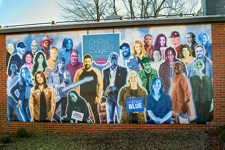 A colorful new mural on the north exterior wall of MTSU's Chris Young Cafe, officially opened in a special livestreamed ceremony Wednesday, Jan. 27, shows the multiplatinum country entertainer and Murfreesboro, Tenn., native at center left, flanked by MTSU President Sidney A. McPhee at center right, and more than two dozen MTSU-trained musicians and media members, educators and leaders from throughout the community. Leslie Haines, a professor of visual communication in the college's School of Journalism and Strategic Media, and Jonathan Coulter Trundle, a professor of photography in the Department of Media Arts, designed the mural for the cafe, a 1963-era cafeteria refurbished into a teaching and rehearsal space and performance venue with help from a donation from Young. Click on the image for a PDF to identify each of the mural subjects and their MTSU connections. (MTSU photo by J. Intintoli)
