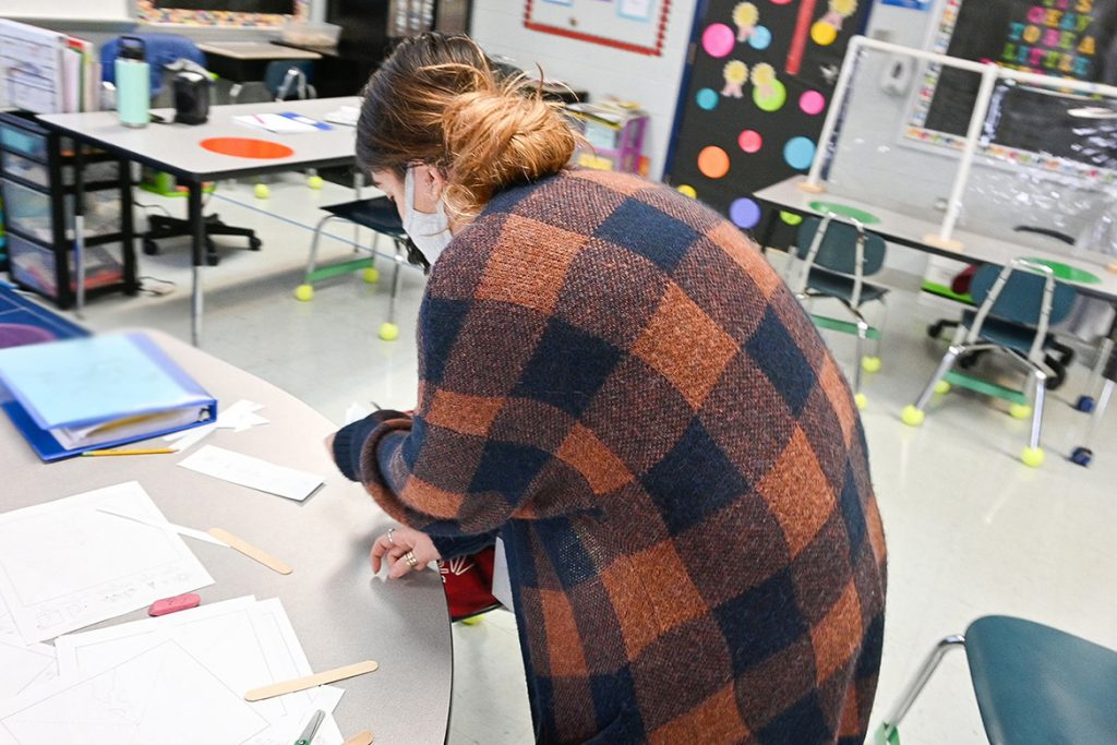 Corinne Keene, special education teacher and former Middle Tennessee State University student, helps one of her students with an arts and crafts project at Wilson Elementary School in Murfreesboro on Jan. 15, 2020. (MTSU photo by Stephanie Barrette)
