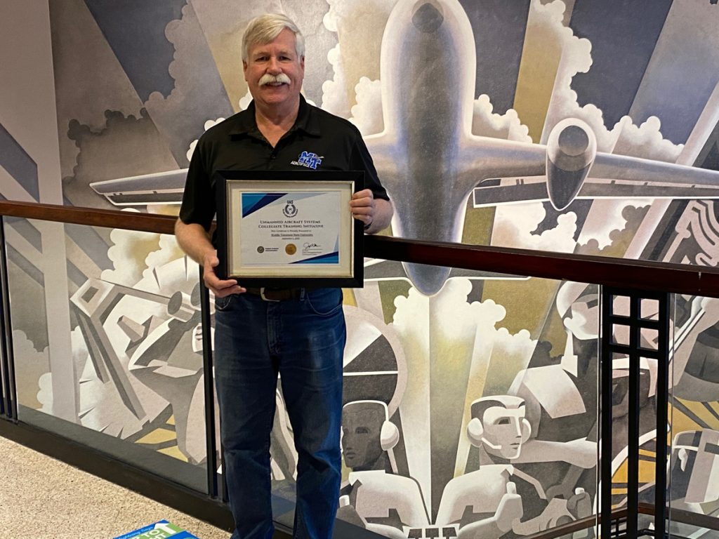 Kevin Corns, MTSU UAS Operations director and assistant professor in the Department of Aerospace, holds the certificate sent by the FAA, acknowledging the Collegiate Training Initiative program that the aerospace department is now a part of since September. The program recognizes institutions that prepare students for careers in unmanned aircraft systems, commonly called drones. (MTSU photo by Mary Lou Cornett)