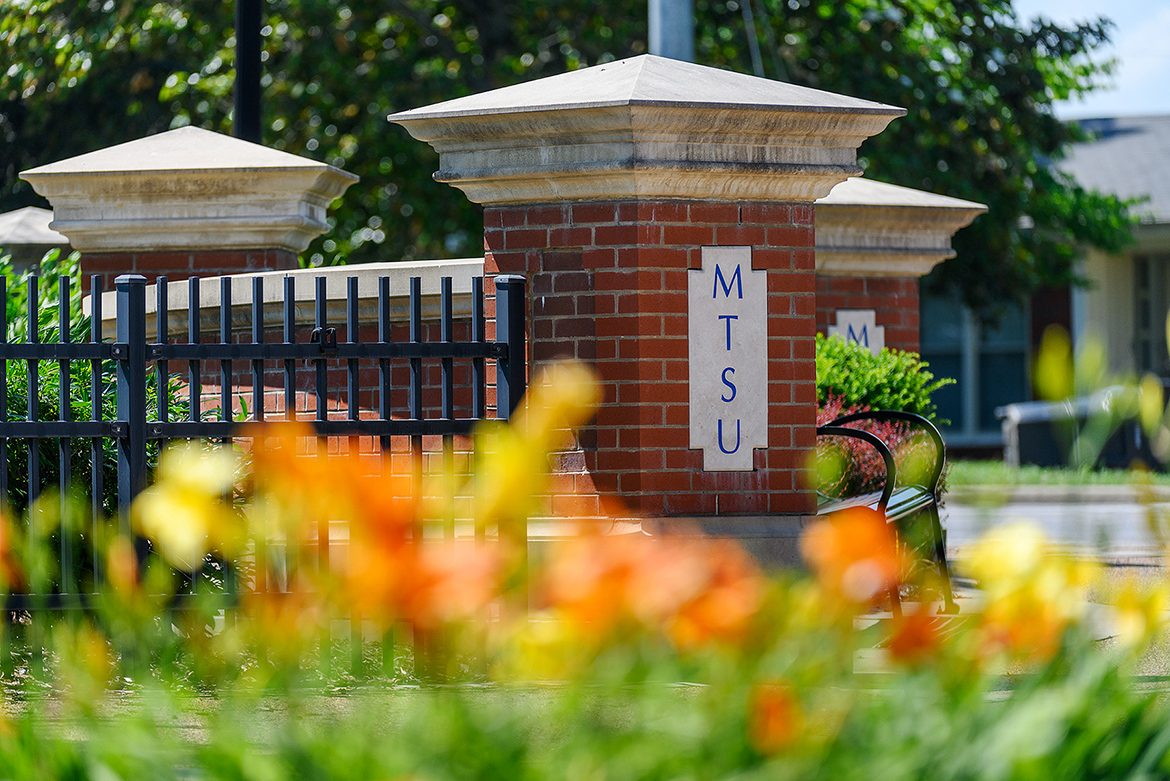 This June 2020 file photo shows the Blue Raider Drive entrance to Middle Tennessee State with blooming flowers. (MTSU file photo by J. Intintoli)