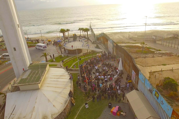 """Arturo O'Farrill, the Afro Latin Jazz Orchestra and special guests play at the border wall in Tijuana, Mexico, in this May 2018 file image provided by makers of the documentary """"Fandango at The Wall."""" (file image courtesy of FandangoWall.com)"""