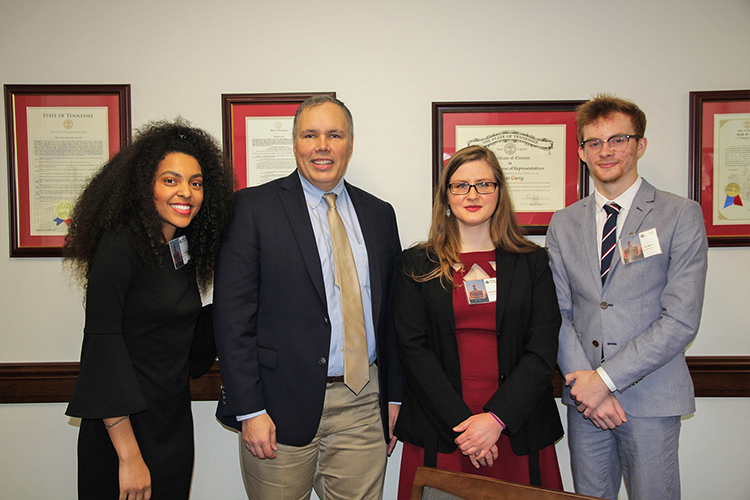 Middle Tennessee State University students Tia Shutes, left, Kayley Stallings, center, and Aric Moilanen, right, pose with Tennessee state Rep. Bryan Terry at the Posters at the Capitol event in February 2020 at the Cordell Hull Building in Nashville, Tenn. The students were participants in the university's Undergraduate Research Experience and Creative Activity grant program. (MTSU photo by Casey Penston)