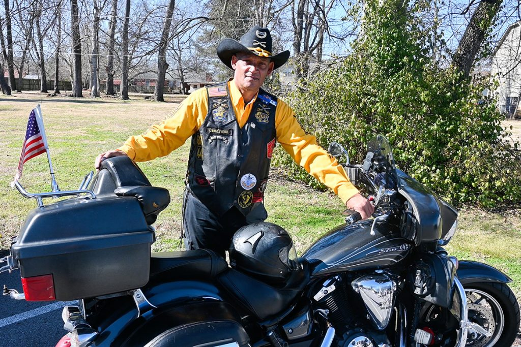 Leroy Carter, Middle Tennessee State University police officer, stands in his Buffalo Soldiers and Troopers Motorcycle Club uniform with his 2012 Yamaha V Star 1300 Tourer bike on campus on Feb. 5, 2021. (MTSU photo by Stephanie Barrette)