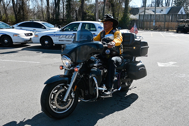 Middle Tennessee State University police officer Leroy Carter, a member of the Buffalo Soldiers motorcycle club, rides his 2012 Yamaha V Star 1300 Tourer motorcycle around the police department parking lot on Feb. 5, 2021. (MTSU photo by Stephanie Barrette)