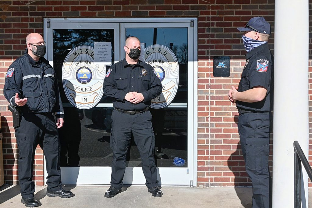 Jason Hurley, left, Middle Tennessee State University Police training sergeant, talks to the university's newest recruit officers Erik Libby, center, and Cody Choate, right, outside of the campus police department on Jan. 22, 2021. (MTSU photo by Stephanie Barrette)