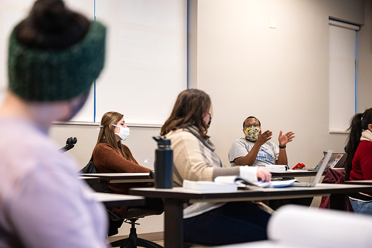 Middle Tennessee State University graduate students listen to Jalen Mims during a discussion in Jim Rost's education course on campus on Feb. 2, 2021. (MTSU photo by Cat Murphy)