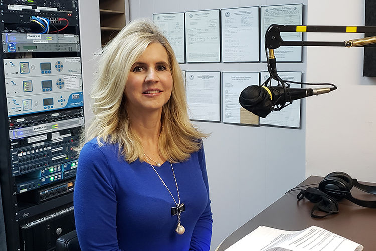 """Maigan Wipfli, director of the June Anderson Center for Women and Nontraditional Students, appears on the March 15 WGNS """"Action Line"""" program with host Scott Walker from the station's downtown Murfreesboro studio. (MTSU photo by Jimmy Hart)"""
