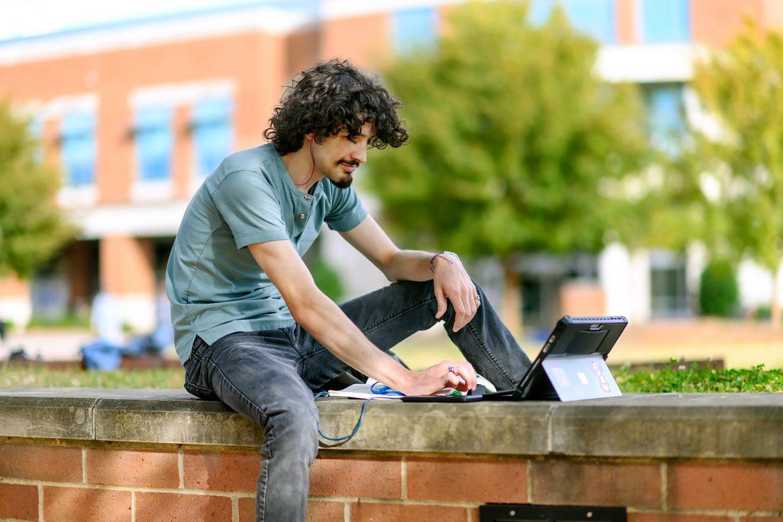 William Ferguson studying outside STU.