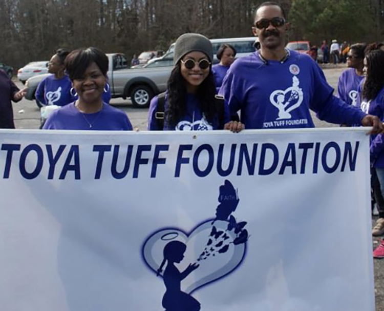 In this undated photo, Middle Tennessee State University alumnus Ed Stegall, right, is pictured with his wife, Barbara, left, and daughter, Michelle, at an event for the Toya Tuff Foundation. The Stegall family created the foundation in memory of LaToya Stegall, who had cerebral palsy and subsequently passed away. The foundation provides assistace to special needs children. (Submitted photo)