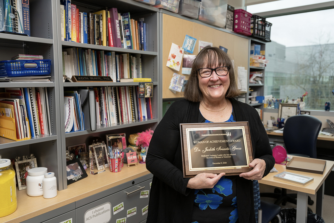 MTSU chemistry professor Judith Iriarte-Gross, recipient of the 2020 Woman of Achievement Award from the Women in Higher Education in Tennessee, holds the award inside her office in the Science Building. (MTSU photo by Andy Heidt)