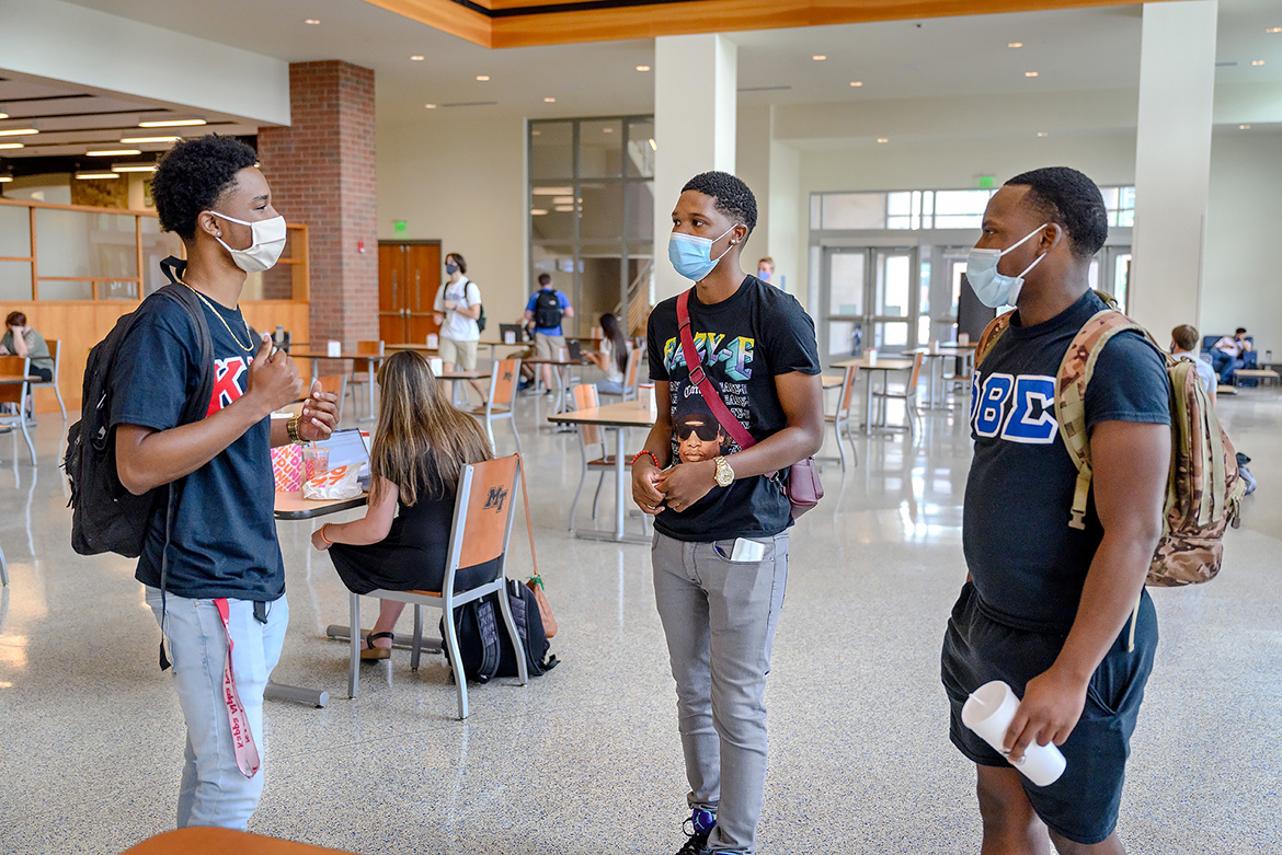 From left, MTSU students Caleb Oatis, JC Mason III, and Carl Brown catch up with other on the first day of Fall 2020 classes as students returned to modified on-campus classes after the pandemic moved all classes to remote instruction for spring and summer. MTSU President McPhee announced this week that the university plans to return to primarily in-person classes and activities for Fall 2021. (MTSU file photo by J. Intintoli)
