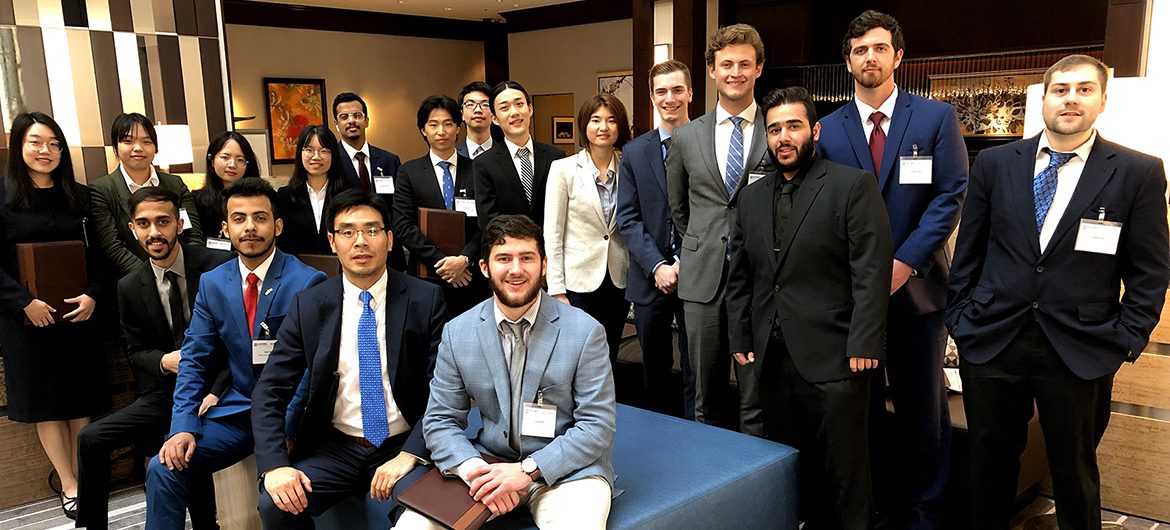 Economics and Finance professor Kevin Zhao, seated in blue tie, is shown with his entire Spring 2019 TVA Investment Challenge class at the TVA's annual Challenge Conference in Nashville, Tenn. The annual competition allows college students from universities throughout the region an opportunity to manage a real stock portfolio to hone their analytical skills. (Submitted photo)
