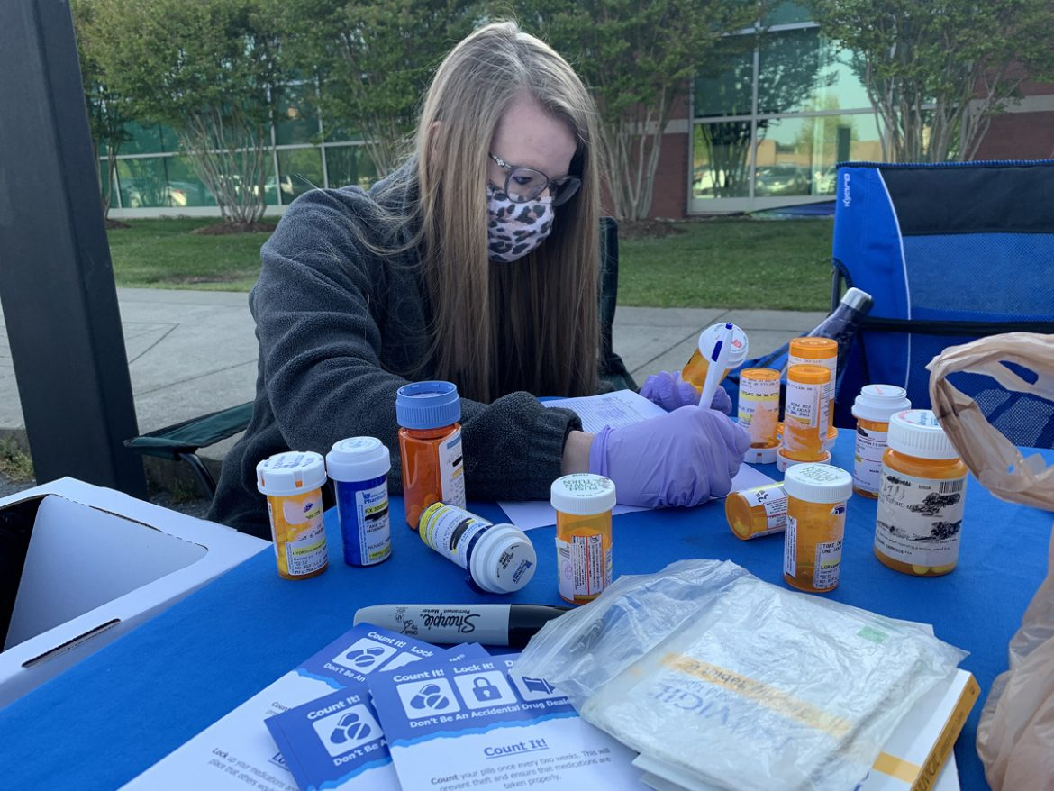 Lipscomb University College of Pharmacy second-year student Kaitlyn Monsue of Dickson, Tenn., documents some of the prescription medications turned in by the public for the spring MTSU Drug Take-Back Day event Thursday, April 22, outside the Health, Wellness and Recreation Center on Blue Raider Drive. Nearly 72 pounds was collected by the end of the 5-plus hour drive to gather old and unwanted medications. (MTSU photo by Randy Weiler)