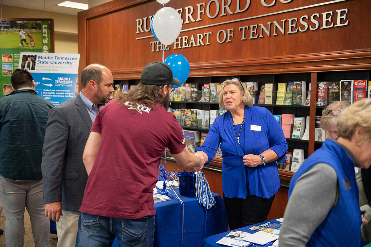 In this file photo, MTSU staff answers questions at a Finish Your Degree Q-and-A event for prospective students in late October 2019 at the Rutherford County Chamber of Commerce in Murfreesboro, Tenn. The college will hold a similar event April 13, 2021, at the chamber under COVID-19 protocols. (MTSU file photo by James Cessna)