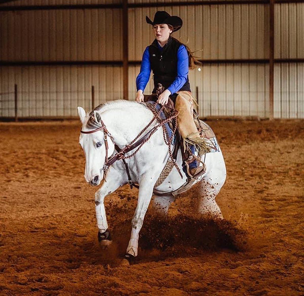 JoBeth Scarlett, a sophomore animal science major from New Market, Tenn., rode Dontjacwithmyspook to the ASHA National Novice Trail, Reining and Cow horse Class championship in the National Champion, Novice division April 16-17 in the Nolan County Coliseum in Sweetwater, Texas. (Submitted photo by Abbey Bratcher)