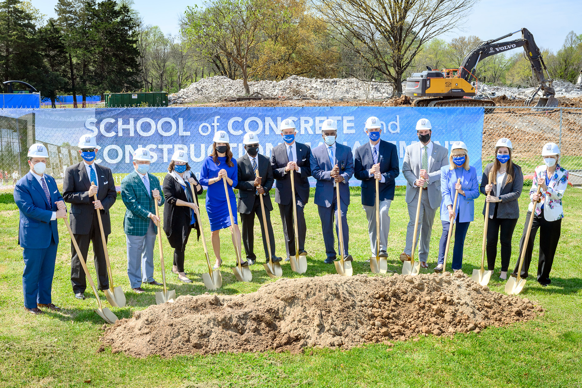 MTSU officials celebrated the groundbreaking ceremony for the 54,000-square-foot, $40.1 million School of Concrete and Construction Management Building on the southeast side of campus Tuesday, April 6. Ceremonial shoveling of dirt participants included, from left, Pete DeLay, trustee; Tom Boyd, trustee; J.B. Baker, trustee; Mary Martin, faculty trustee; Heather Brown, professor of concrete industry management; MTSU President Sidney A. McPhee; Stephen Smith, Board of Trustees chairman; Darrell Freeman, trustee vice chairman; Kelly Strong, director, MTSU School of Concrete and Construction Management; Daniel Bugbee, CIM (Concrete Industry Management) Patrons president; Pam Wright, trustee; Delanie McDonald, student trustee; and Christine KarbowiakVanek, trustee. (MTSU photo by J. Intintoli)