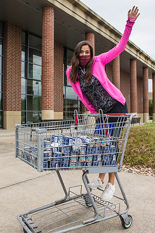 Rachel Frankenberger, a member of the Greek Week Committee, poses with nonperishable food items donated to the Student Food Pantry during Greek Week and delivered to the pantry April 14. (Submitted photo by Kimberly Garvey)