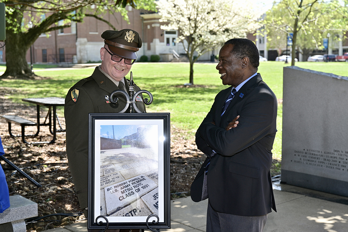 Brig. Gen. Robert S. Powell Jr., left, an MTSU alumnus, and university President Sidney A. McPhee share a laugh following the Monday, April 12. ceremony honoring Powell, now the 17th general officer to emerge from the 71-year ROTC program. MTSU presented a framed portrait of the brick, which has been placed at the Veterans Memorial site. (MTSU photo by Andy Heidt)