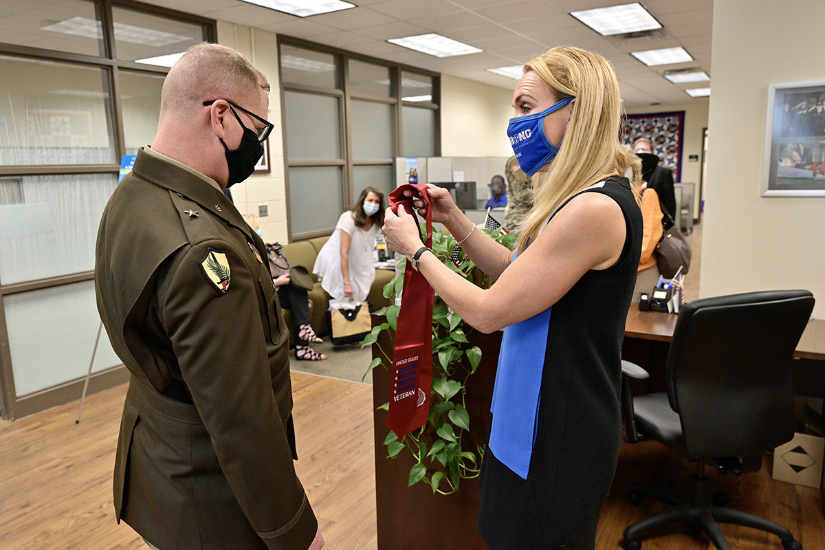 U.S. Army Reserve Brig. Gen. Robert S. Powell Jr., left, talks with Hilary Miller, director of the Charlie and Hazel Daniels Veterans and Military Family Center, on Monday, April 12, as she displays one of the special red stoles provided to graduating student veterans. Powell, who is the 17th MTSU alumnus to become a general officer, toured the Daniels Center after being recognized earlier that day with the unveiling of a commemorative brick at the MTSU Veterans Memorial site on campus. (MTSU photo by Andy Heidt)