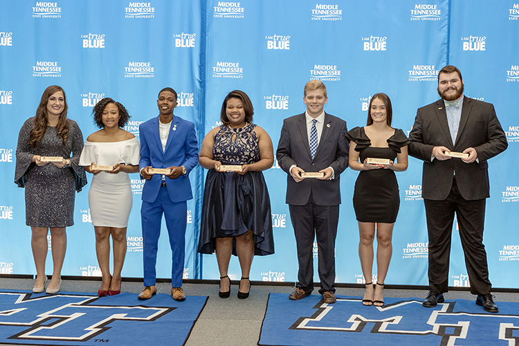 Chelseah Moore, second from left, joins other award winners at the 2019 Student Government Association Banquet in the Student Union Ballroom. Others include, from left, Delanie McDonald, Moore, J.C. Mason, Deja Watts, Preston George, Alex Revor and Nate Parris. (MTSU photo by J. Intintoli)