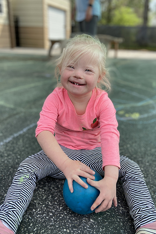 "One of the little learners at MTSU's Ann Campbell Early Learning Center giggles while taking a break from playing outside on the center's paved play area. The nonprofit, inclusive preschool, an arm of MTSU's College of Education, is holding a drive-thru version of its annual ""Saddle Up"" fundraiser on Saturday, April 17. For more information, visit https://www.mtsu.edu/acelearningcenter/saddleup.php. (Photo courtesy of the Ann Campbell Early Learning Center at MTSU)"