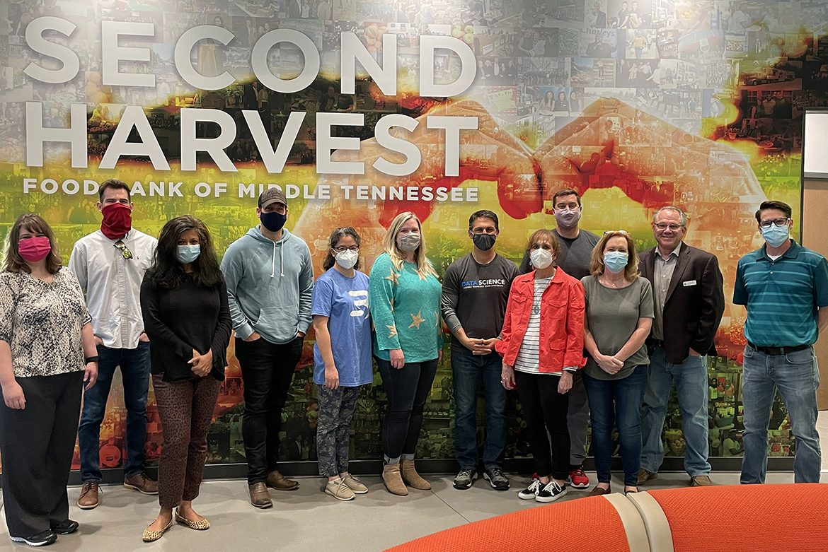 Some students in the inaugural cohort of MTSU's data science graduate certificate program visit Second Harvest Food Bank of Middle Tennessee's warehouse location in Nashville, Tenn., on April 11. Second Harvest provided the group access to some of its databases as part of the students' final class project. Pictured, from left, are students Tammy Wiseman, McKinley Tidwell, Shalini Gupta, Vince Herbert, Ying Ding, Emily Hines; Charlie Apigian, co-director of the MTSU Data Science Institute and professor; student Sheryl Dusek; Ryan Otter, institute co-director and professor; student Beverly Meadows; Frank Ellmo, Second Harvest's senior director of operations; and David Tinsley, director of information systems and information technology at Second Harvest. (Photo by Charlie Apigian)