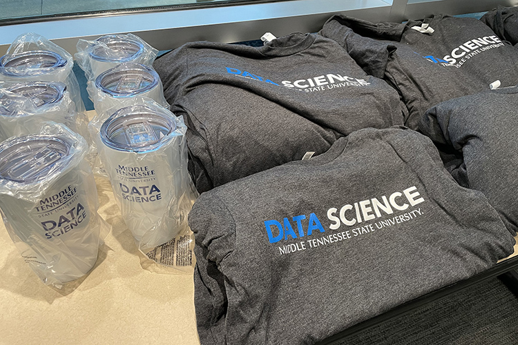 MTSU Data Science travel mugs and T-shirts on display at Second Harvest Food Bank of Middle Tennessee. (MTSU photo by Charlie Apigian)