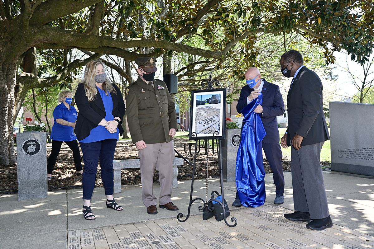 Brig. Gen. Robert S. Powell Jr., an MTSU alumnus, and his wife and fellow alum, Jill, watch as Keith M. Huber, senior adviser for veterans and leadership initiatives, and MTSU President Sidney A. McPhee unveil a framed photograph of the commemorative brick that was placed at the MTSU Veterans Memorial site outside the Tom H. Jackson Building Monday, April 12. Powell is the 17th MTSU alumnus to become a general officer. The deputy commanding general of the 335th Signal Command in East Point, Georgia, is a 1991 graduate from the university and its ROTC program. (MTSU photo by Andy Heidt)