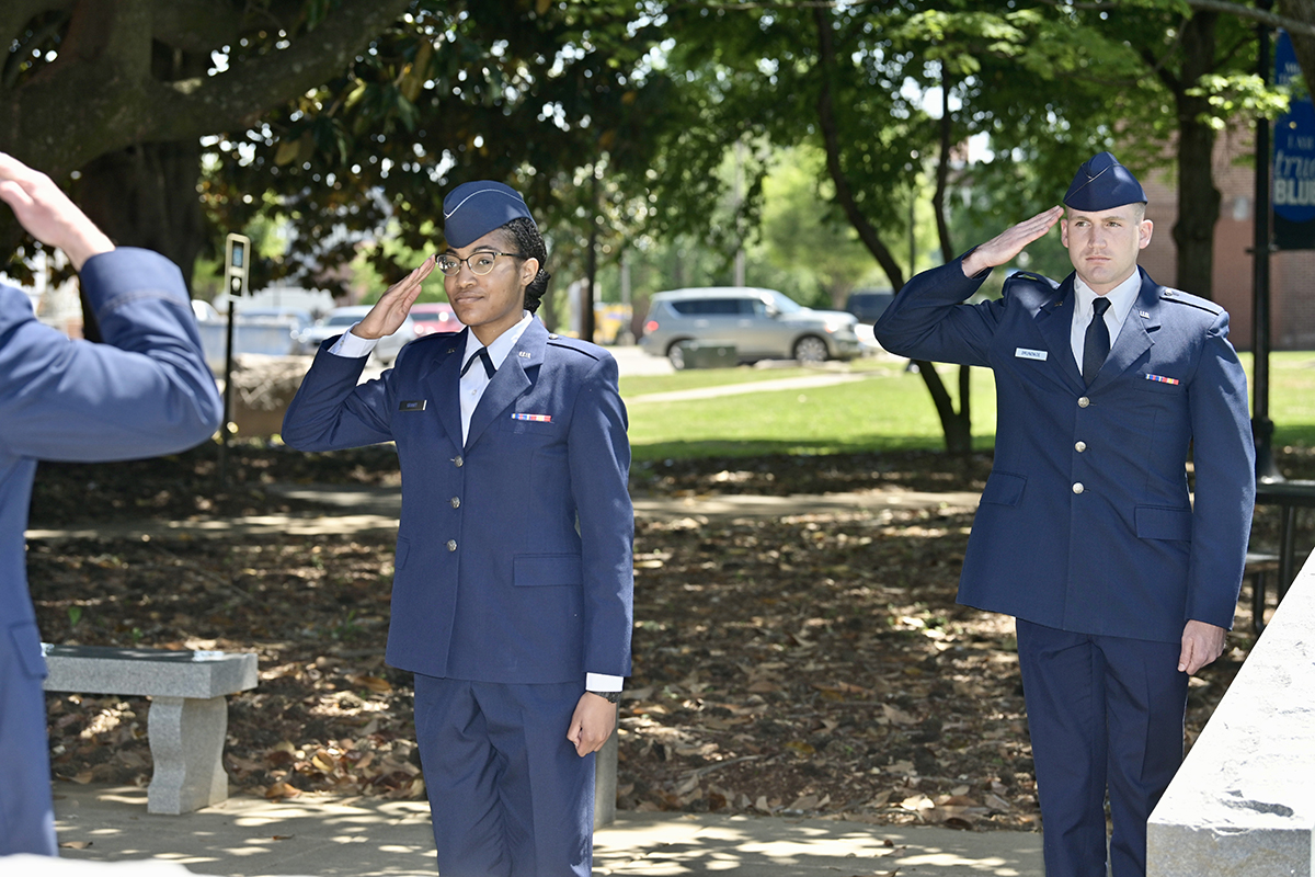 Recent Vanderbilt University graduate Asia Grant, left, of Atlanta, Ga., and Tennessee Tech graduate Erich Brundage of Bay St. Louis, Miss., take part in the First Salute during the May 15 Air Force ROTC Detachment 790/Tennessee State University spring commissioning ceremony held at the Veterans Memorial outside the Tom H. Jackson Building on the MTSU campus. The TSU detachment includes MTSU and about a dozen Midstate and southern Kentucky colleges and universities. (MTSU photo by Andy Heidt)