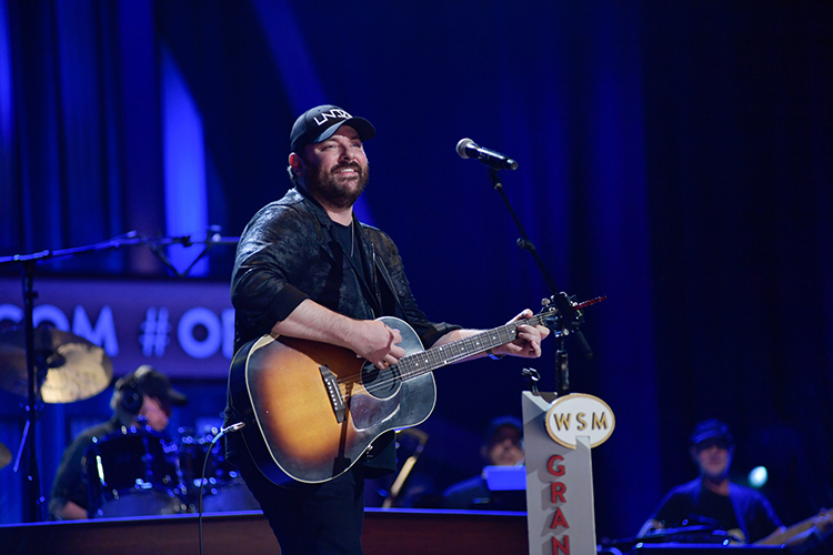 MTSU alumnus and country music artist Chris Young performs from the stage of the Grand Ole Opry during Saturday's sold-out Opry Salute the Troops show in Nashville, Tenn. (MTSU photo by James Cessna)